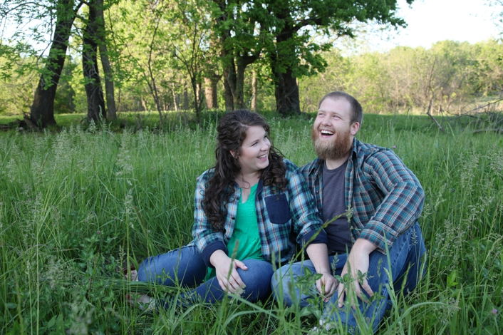 Outdoor engagement session with field of tall grass, flannel outfits