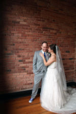 Classic wedding portrait of a bride and groom by Creative Event Studio taken at Town Pavilion, Paola KS