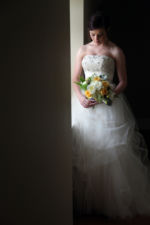 Kansas City Wedding Photographer Romancing the Gowns Bride in Window Sequin Tulle Bridal Gown