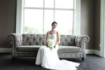 Bride on tufted couch at william jewell college Kansas City Wedding Photographer