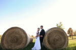 Kansas City Wedding Photographer Smithville Farm DIY Round Haybales Bride wearing plaid