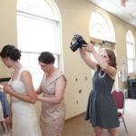 Kansas City Wedding Photographer at William Jewell College with the Bride Getting Dressed