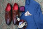 grooms attire details navy suit brown shoes whiskey bottle at 28 event space sarah and ginger photography kansas city